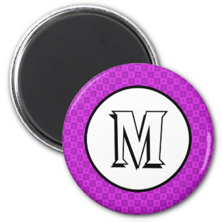Círculos y cuadrados del monograma en un modelo imán redondo 5 cm