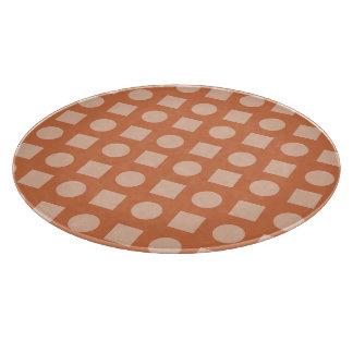 Círculos y rojo anaranjado del cuadrado tablas para cortar