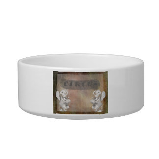 Circus design, text and elephants in corner cat food bowls