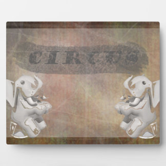 Circus design, text and elephants in corner photo plaques