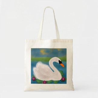 Cisne blanco en la charca en la puesta del sol bolsa tela barata