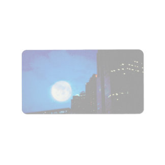 City at night with moon address label