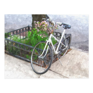 CITY BIKE WITH BASKET COVERED IN FLOWERS POOSTCARD POSTCARD
