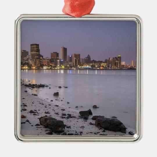 City lights at twilight with debris strewn beach metal ornament