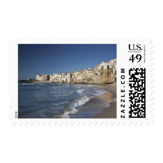 City of old buildings on beach stamps