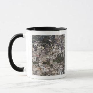 City of old buildings on hillside mug