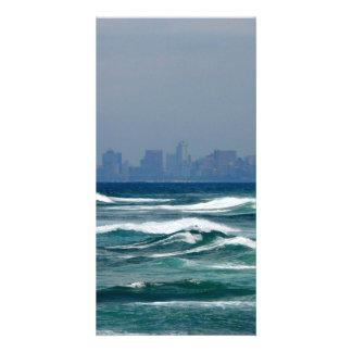 City Skyline behind the waves of the ocean Card