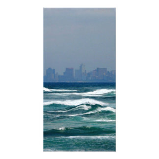 City Skyline behind the waves of the ocean Photo Card