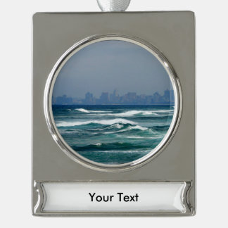 City Skyline behind the waves of the ocean Silver Plated Banner Ornament