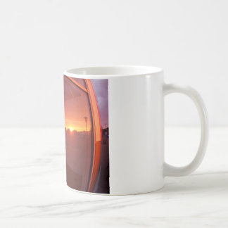 Cityscape at sunset, which is reflected in the win coffee mug