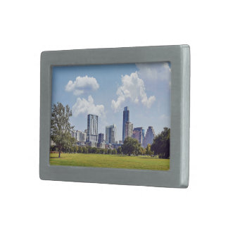 Cityscape on a nice, clear day belt buckles