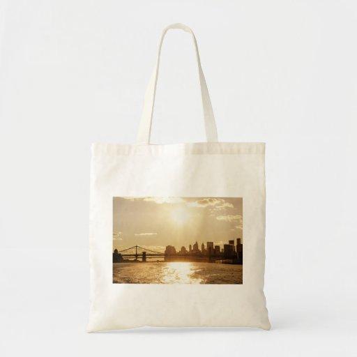 Cityscape Sunset over the New York Skyline Bags