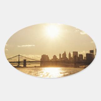 Cityscape Sunset over the New York Skyline Oval Sticker