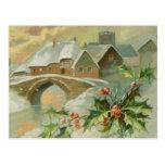 Ciudad del navidad del vintage con acebo postales