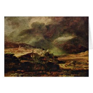 Ciudad en una colina en clima tempestuoso de tarjeta de felicitación