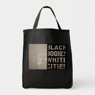 Ciudades del blanco de los cuerpos negros bolsa