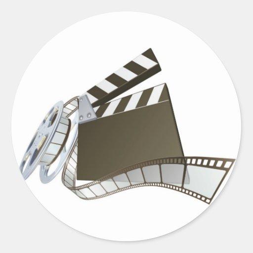 Clapperboard de la película y carrete de la pegatinas redondas