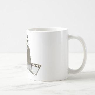 Clapperboard de la película y carrete de la pelícu tazas de café