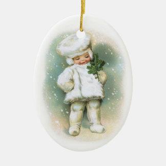 Clapsaddle: Muchacho del invierno con la ramita Adorno Navideño Ovalado De Cerámica