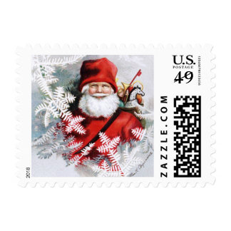 Clapsaddle: Santa Claus with Toys and Fir Twigs Stamp