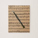 Clarinet con el fondo de la partitura rompecabeza con fotos