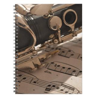Clarinet y hojas de música cuadernos