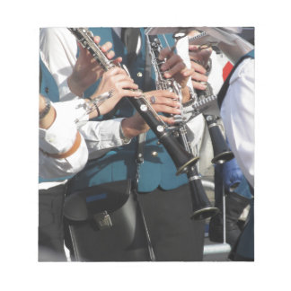 Clarinets in the hands of the musicians notepad