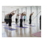 class practicing yoga with instructor in a 2 poster