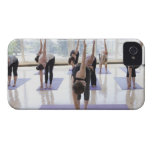 class practicing yoga with instructor in a iPhone 4 Case-Mate case