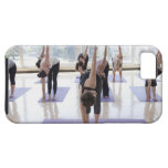 class practicing yoga with instructor in a iPhone 5 cover