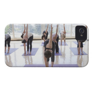 class practicing yoga with instructor in a Case-Mate iPhone 4 case