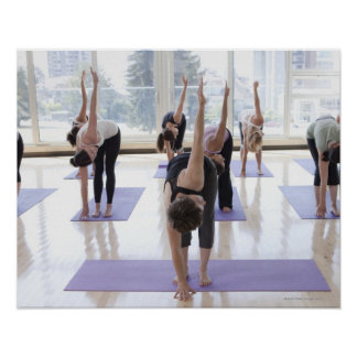 class practicing yoga with instructor in a posters
