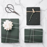 """Classic bold holiday plaid and stars hunter green wrapping paper sheets<br><div class=""""desc"""">A bold modern take on a classic holiday plaid makes this wrapping paper set perfect way for both traditional and unconventional gift givers. The hunter green background with the tilted black and white checks is chic and stylish. Also includes a coordinating sheet dotted with stars. Will look fantastic on all...</div>"""