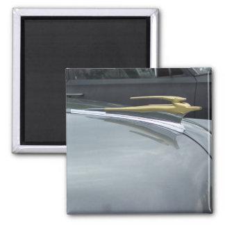 classic car golden hood ornament magnet