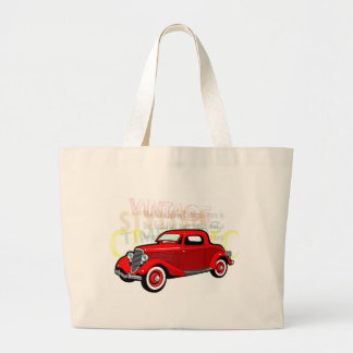 Classic car, old vintage coupe in red canvas bags