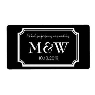 Classy monogram wedding wine or water bottle label