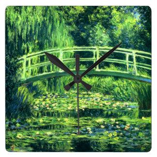 Claude Monet Puente sobre una charca de los lirio Reloj De Pared