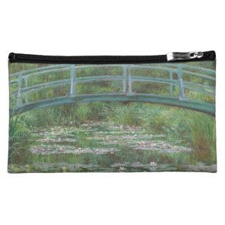 Claude Monet's The Japanese Footbridge Makeup Bags