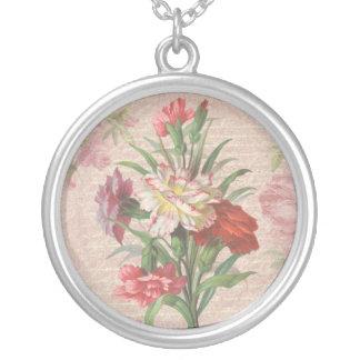 Claveles del vintage con el fondo floral de la colgante redondo