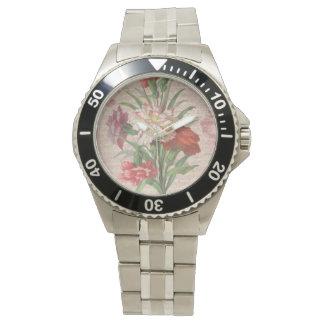 Claveles del vintage con el fondo floral de la relojes de pulsera