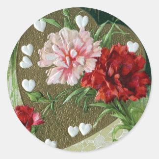 Claveles y tarjeta del día de San Valentín del Pegatina Redonda