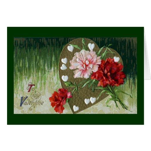 Claveles y tarjeta del día de San Valentín del vin