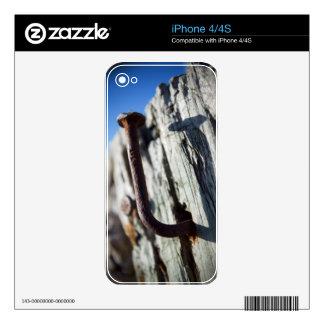 Clavo doblado en el Sun iPhone 4 Skins