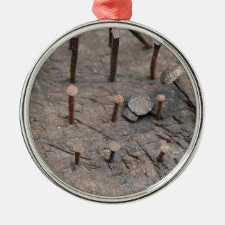 clavos oxidados adorno navideño redondo de metal