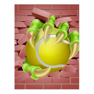 Claw with Tennis Ball Breaking Through Brick Wall Postcard