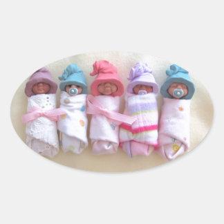 Clay Babies, Elf Hats, Sleeping, Swaddled, Cute Oval Sticker