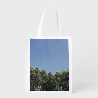 Clear blue sky and treetops market totes