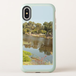 clear lake at Almaden lake park in san jose with m OtterBox Symmetry iPhone X Case