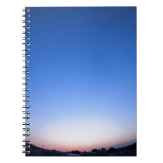 Clear skies over the city after sunset notebook