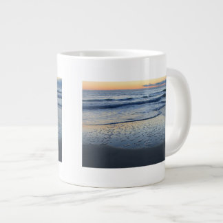 clearing storm at the beach large coffee mug